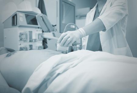 Ultrasonic examination in the hospital, monochrome background.