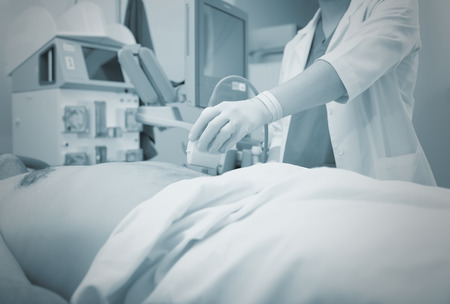 Ultrasonic examination in the hospital, monochrome background. Imagens - 75066060