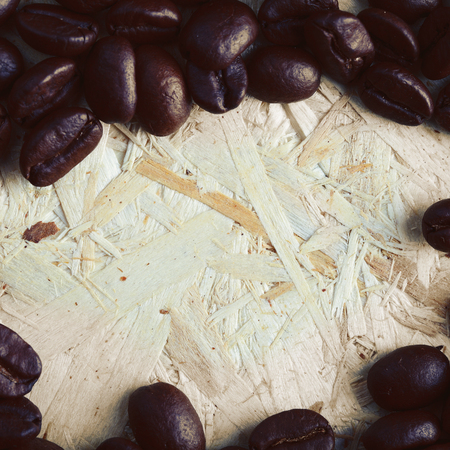 Coffee beans on a wooden surface 版權商用圖片