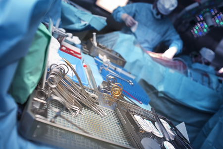 Surgical instruments in the operating room with a working team of surgeons