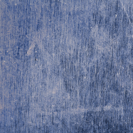 Blue metal surface with scratches and stains