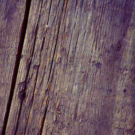 Old wooden board with a gray coating