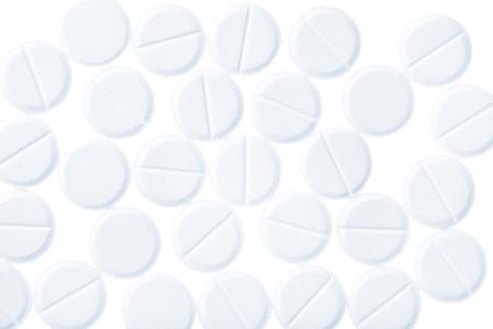 Medical pills of round shaped isolates on white