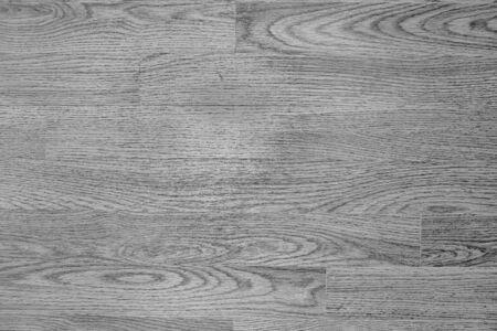 Wooden floor coating, monochrome background.
