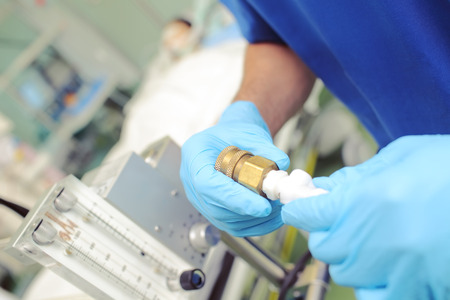 Medical worker in the hospital controls gas passing.