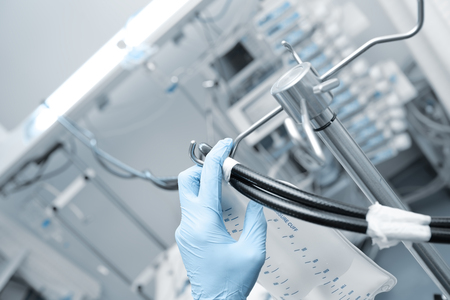 Doctor sets equipment in the ICU.