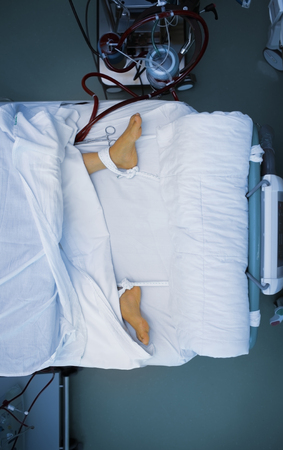 Patient feet attached to the bed.