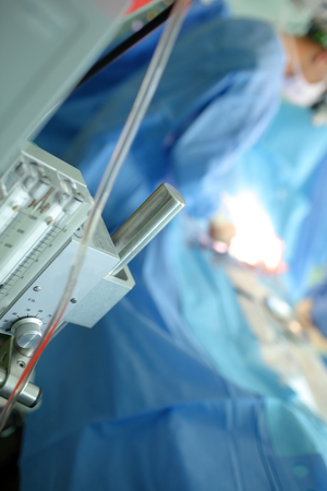 Gas equipment on the background of doctors figure.