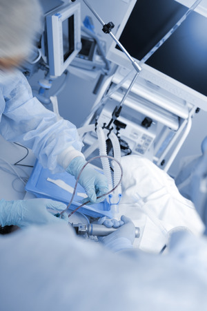 Doctors team provides procedure in the hospital.