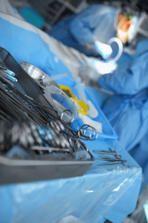 Sterile surgical tools on the table in the operating room.