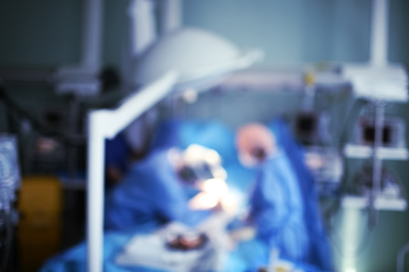 Working medical personnel, unfocused background.