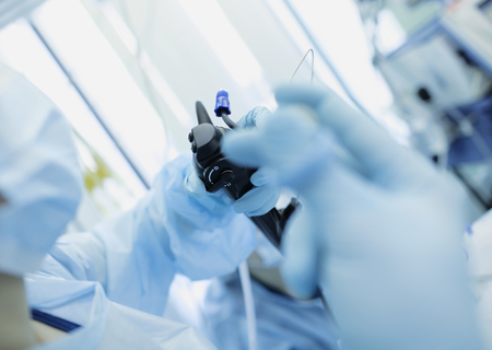 Doctor conducting medical endoscopy procedures.