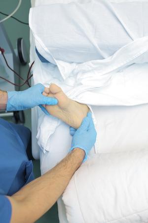 Doctor examines the patients foot.