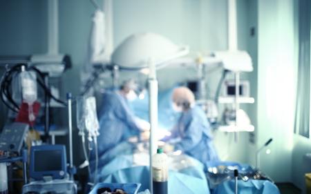 Working surgical team, unfocused background. 版權商用圖片