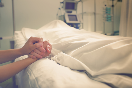Woman mourns her husband, who died in a hospital.