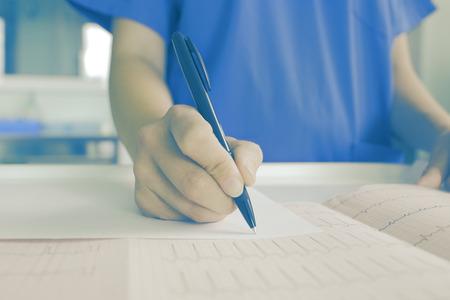 Female doctor examining medical card. 版權商用圖片