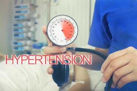 Blood pressure gauge with red inscription hypertension.
