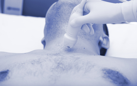 Doctor scrutinize patients neck during ultrasound exam. 版權商用圖片