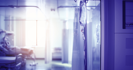 Intravenous drip in the  hospital hall against the probationary ward behind the sight glass.