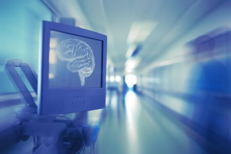 Monitor with brain image and blurred silhouette of doctor in the hospital hallway as a concept of psychiatry.