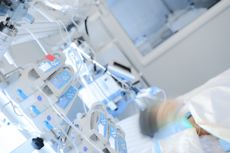 Small child receives treatment in the department of pediatric intensive care.