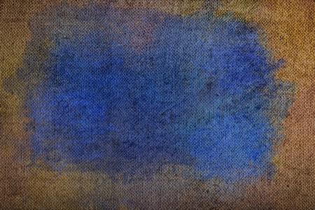 Weft fabric with blue stain, textured background.