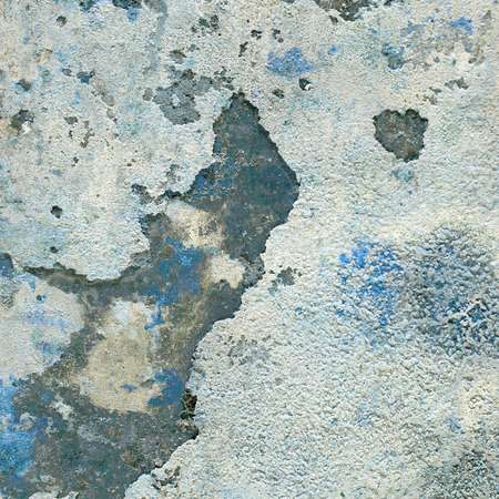 Grunge concrete wall covered with old crumbling plaster, textured background.