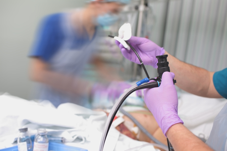Preparation for the performing endoscopic procedure to the patient in the ICU.
