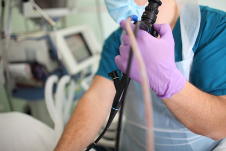 Doctor endoscopist in the process of check-up with an endoscope in the hands