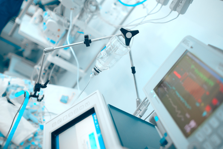 Life support devices connected to the critical condition patient in the ICU. Stock Photo