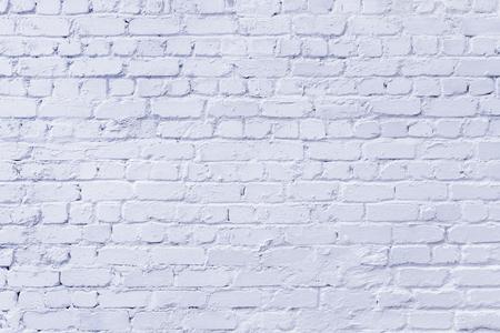 Newly-whitewashed brick wall, textured background.