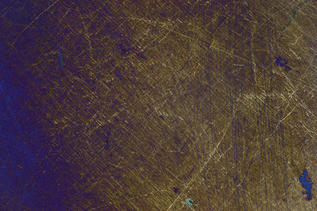 Scraped metallic leaf, textured background.