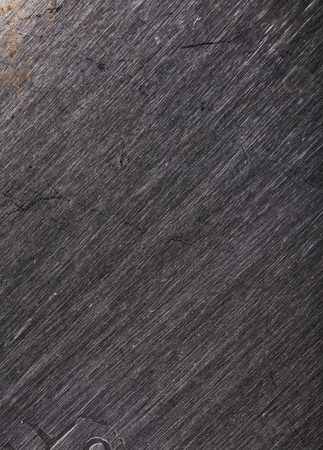 Striped metallic texture with scratches of different depths.
