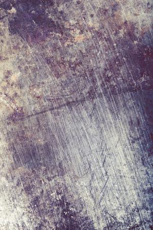 Damaged piece of metal, textured background for design.