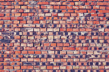 Wall of fired brick, textured background for design.