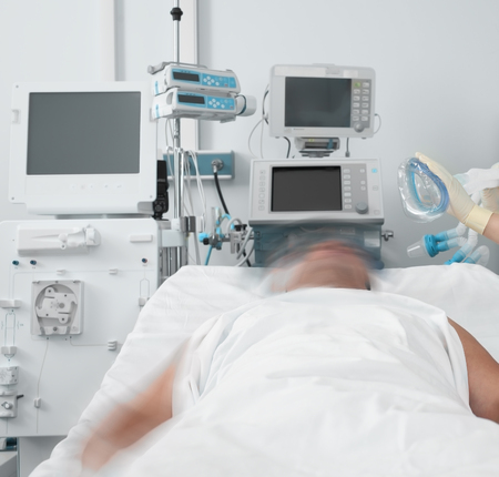 Male patient resists the nurse putting a breathing mask on him.