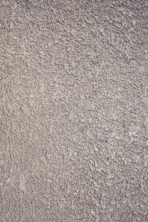 Concrete wall with decorative parget coating, textured background. 版權商用圖片