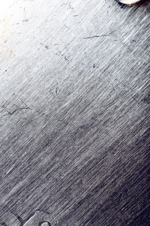 Battered steel surface, textured background for your designing. 版權商用圖片