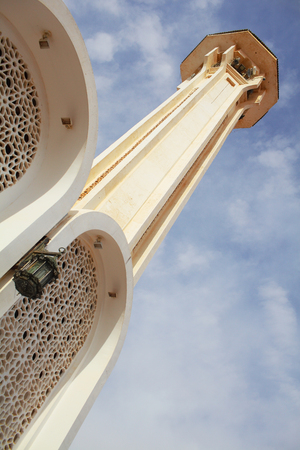 Small tower on the roof of the arabian style building.
