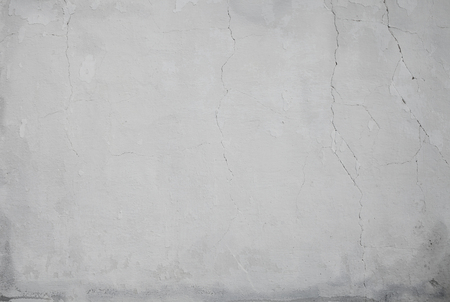 Peeled limed wall with cracks and stains, textured background. 版權商用圖片
