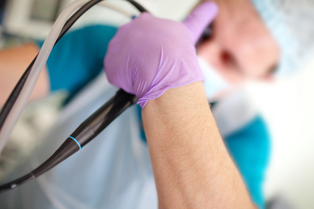 Male doctors arm with endoscopic tool during procedure. 版權商用圖片