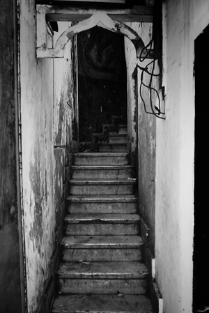 Long staircase between the tumbledown apartments in the city outskirts.