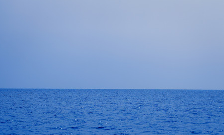 Horizon line between the sea and the sky in the summer evening.