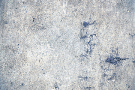 Scratched surface of concrete wall, textured background.