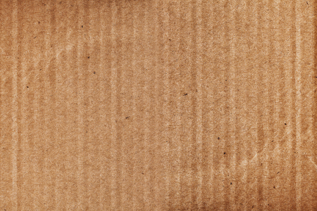 Paperboard textured background with empty space for your designing.