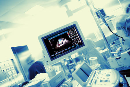 Medical lab with electronic equipment and working staff. Archivio Fotografico