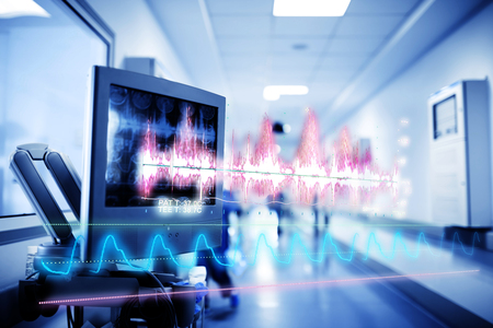 Medical technology concept with a hologram of curves and graphs of data on the background of the equipment inside the hospital