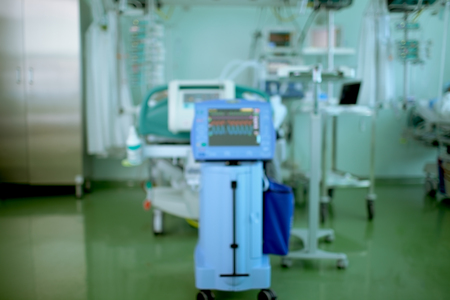 Abstract blurred medical background with monitors and other scientific equipment in the hospital room