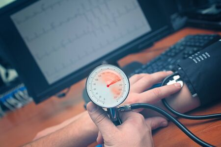 Doctor found in the patient an increase in blood pressure to a critical level during exam. Stock Photo
