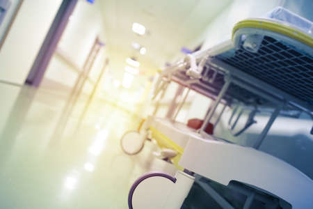 Hospital hall with a bright illuminated exit, defocused background. 版權商用圖片